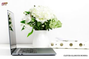 Branded Laptop Computer on white desk with whiteflowers in a white vase. Clever Glamour Momma
