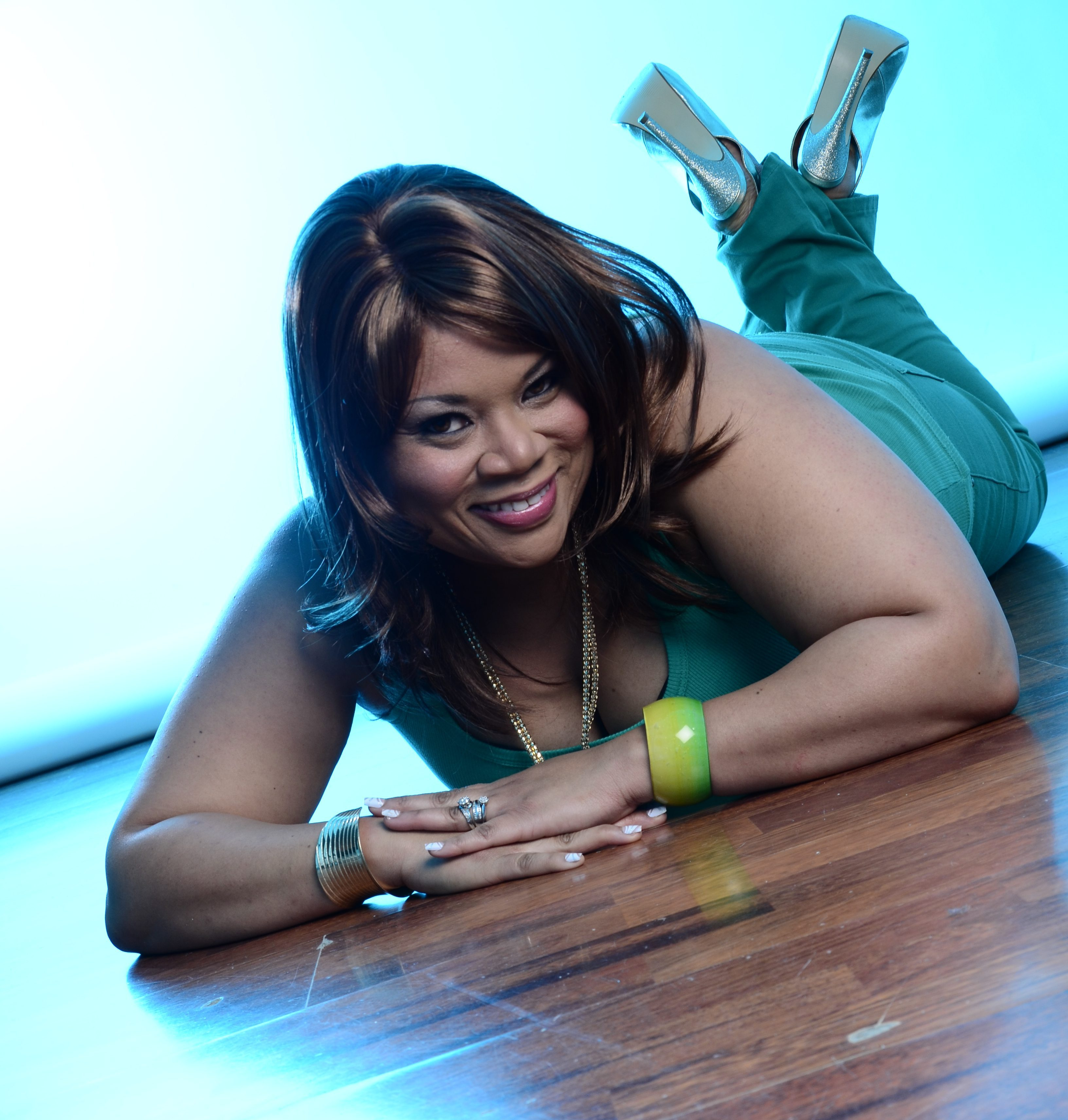 relaxing in green and gold. Lying on the floor with gold shoes and a green outfit.